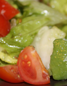 Little Gem salad with cherry tomatoes and avocado