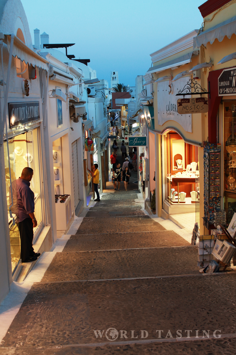 Small streets and jewelry shops are typical for Fira